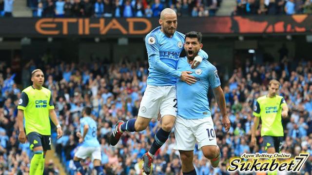 Hattrick Aguero Bawa City Tundukkan Huddersfield
